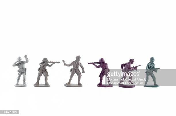 close-up of toy soldiers against white background - human representation stock pictures, royalty-free photos & images