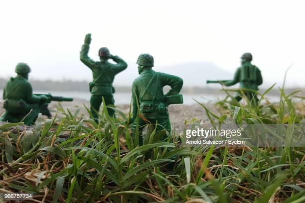 close-up of toy soldiers on grass - army soldier toy stock pictures, royalty-free photos & images