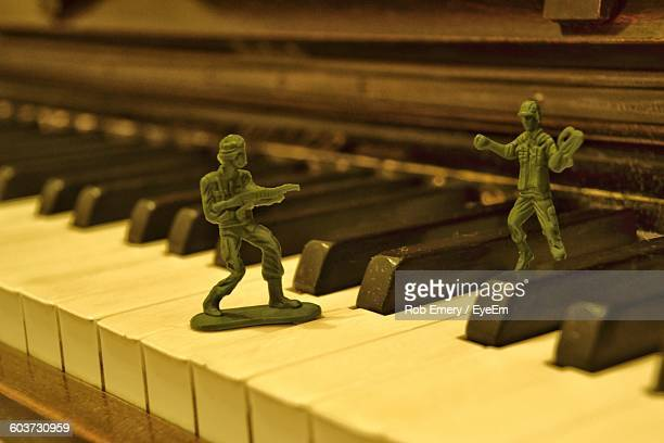 Close-Up Of Toy Soldiers On Piano Keys