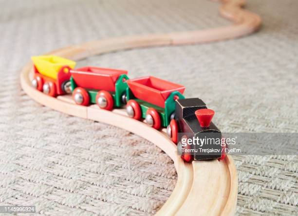 close-up of toy train on table - teemu tretjakov stock pictures, royalty-free photos & images