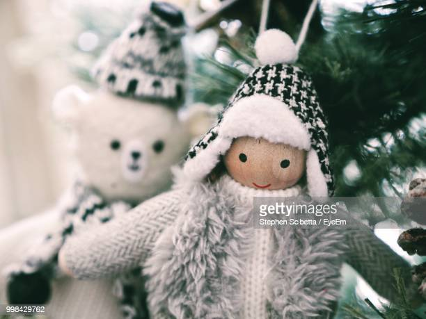close-up of toys hanging on christmas tree - hawaii christmas stock pictures, royalty-free photos & images