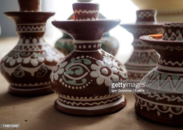 close-up of traditional candlestick holders on table - igor golovniov stock pictures, royalty-free photos & images