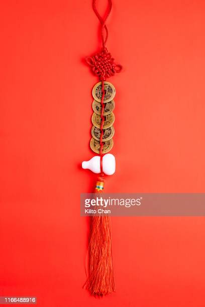 closeup of traditional chinese fengshui decorations against red background - pendant stock pictures, royalty-free photos & images