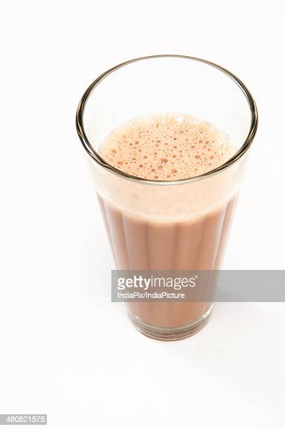 Close-up of traditional Indian milk tea isolated over white background