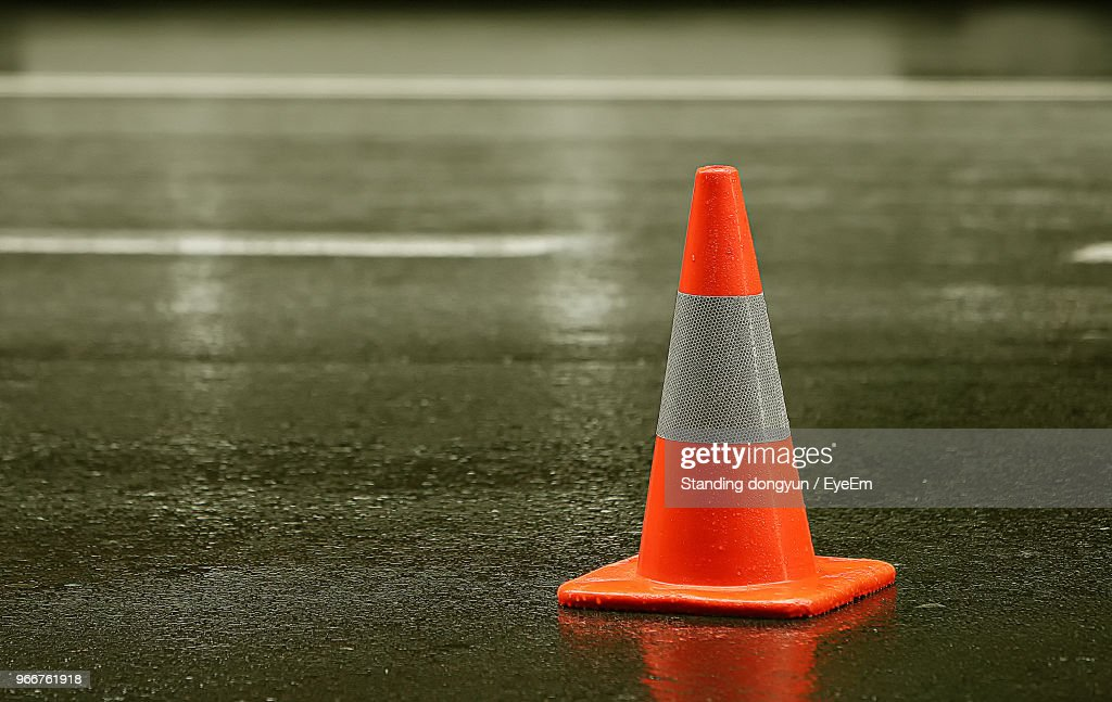 Close-Up Of Traffic Cone On Wet Street : Stock-Foto