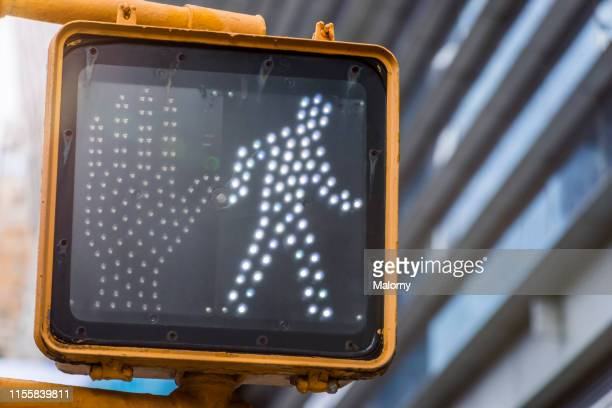 close-up of traffic light for pedestrians. new york city, new york. - crossing sign stock pictures, royalty-free photos & images