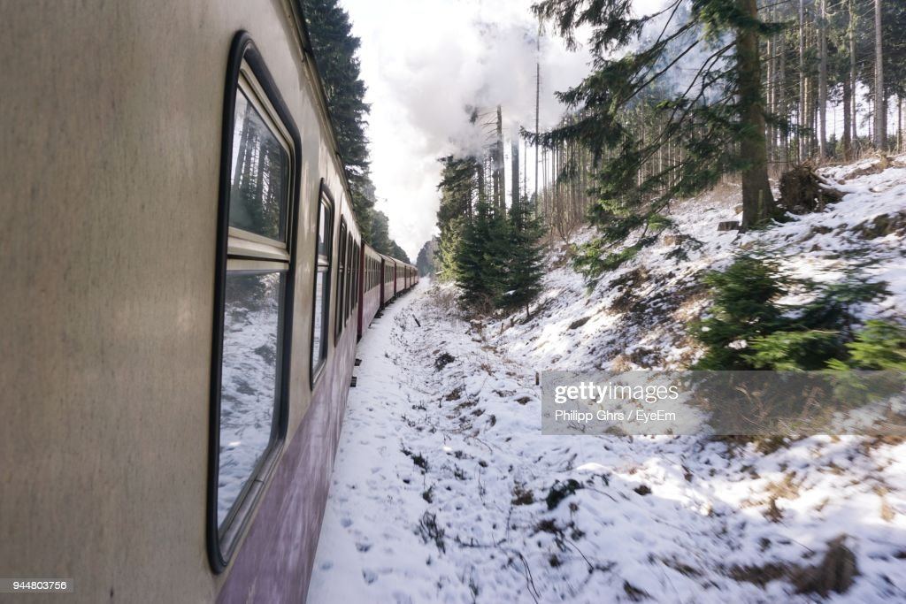 Close-Up Of Train Passing Through Snow Covered Landscape : Stock Photo