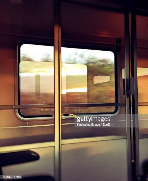 close-up of train window - train interior stock photos and pictures