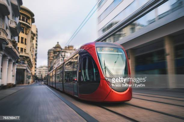 close-up of tram on city street - cable car stock pictures, royalty-free photos & images