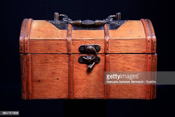 Close-Up Of Treasure Chest Over Black Background