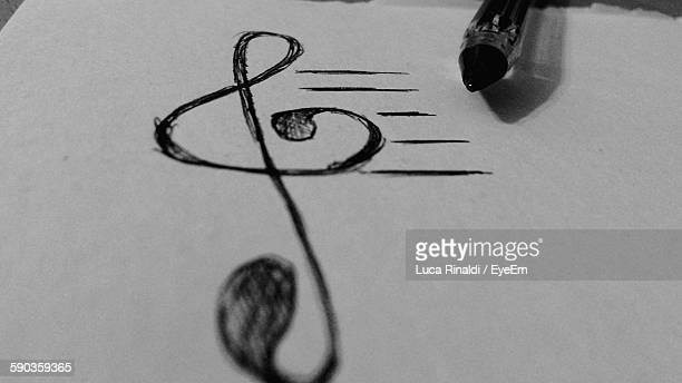 close-up of treble clef by ballpoint pen on paper - chiave di violino foto e immagini stock
