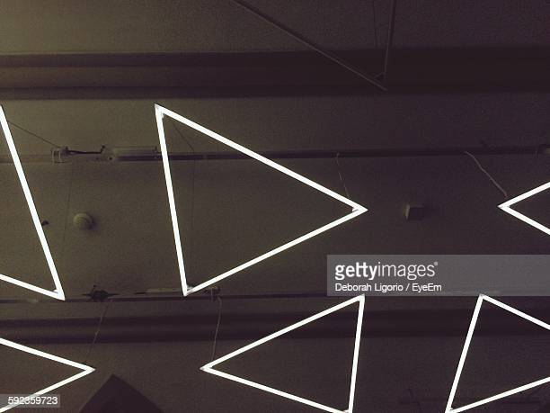 Close-Up Of Triangle Neon Lights On Wall