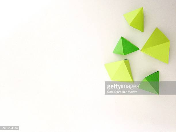 Close-Up Of Triangle Objects Over White Background