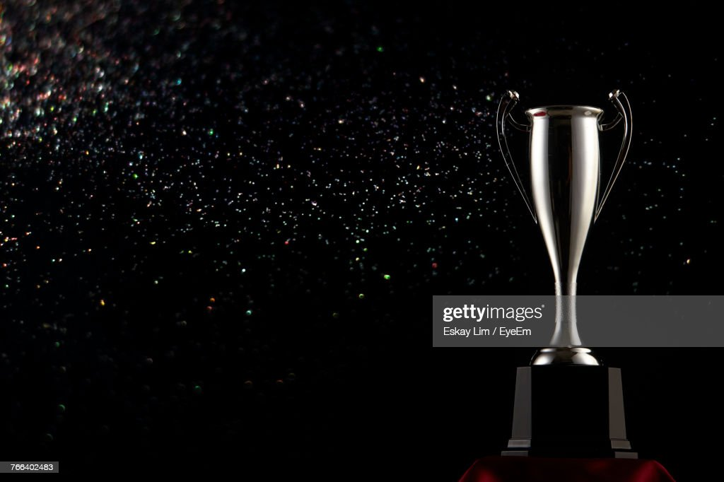Close-Up Of Trophy Against Black Background : Stock Photo