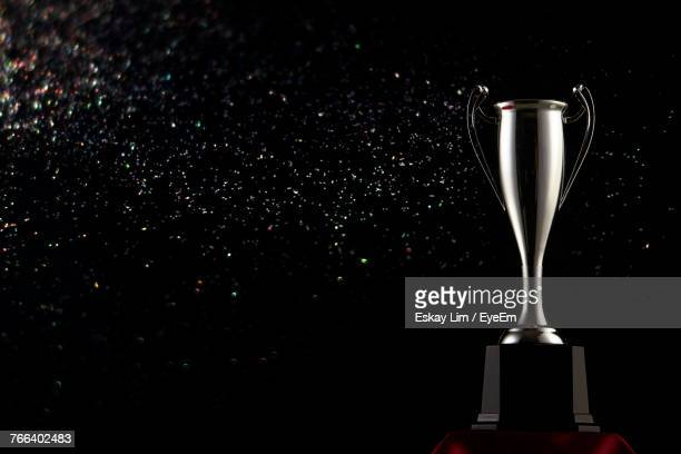 Close-Up Of Trophy Against Black Background