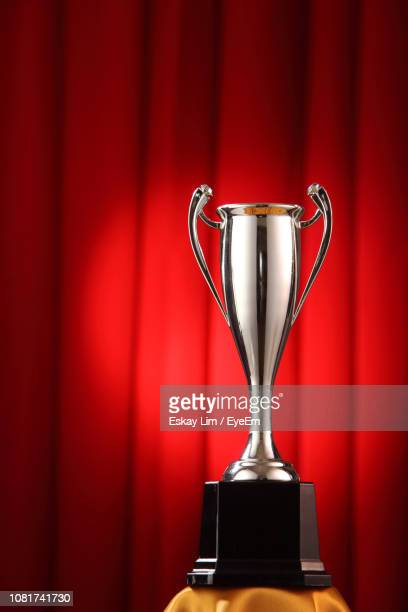 close-up of trophy against red curtain - ceremony ストックフォトと画像