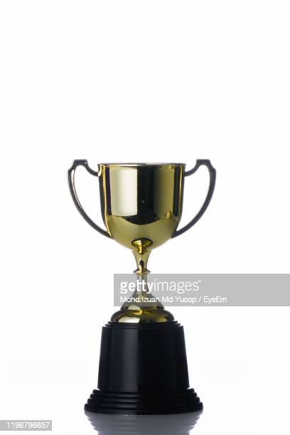 close-up of trophy against white background - cup stock pictures, royalty-free photos & images