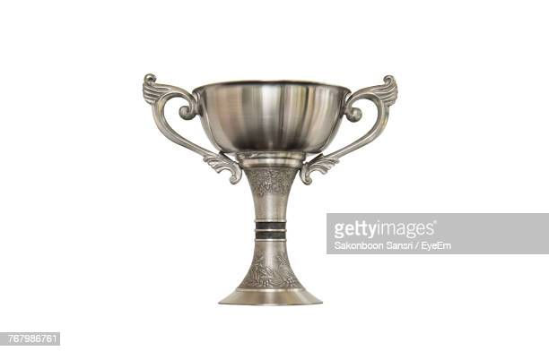 close-up of trophy against white background - trofeo fotografías e imágenes de stock