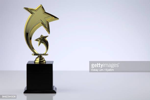close-up of trophy against white background - trophy award stock pictures, royalty-free photos & images