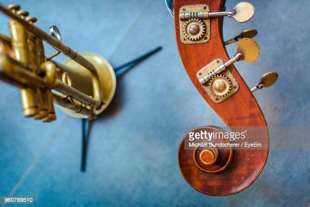 close-up of trumpet and double bass on table - double bass stock photos and pictures