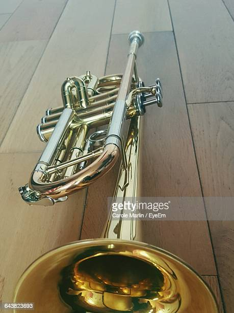Close-Up Of Trumpet On Floorboard