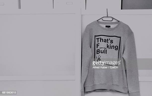 close-up of t-shirt against the wall - alfred weiss stock-fotos und bilder