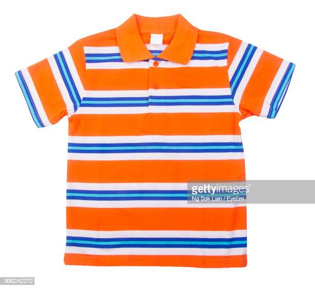 close-up of t-shirt over white background - striped shirt stock pictures, royalty-free photos & images