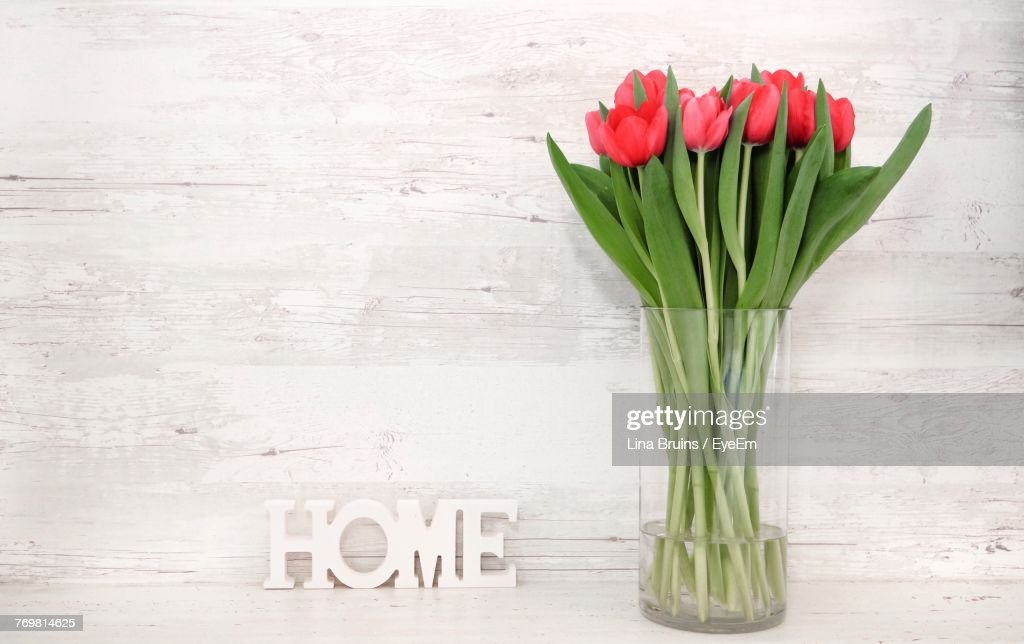 Closeup Of Tulips In Vase On Table Stock Photo Getty Images