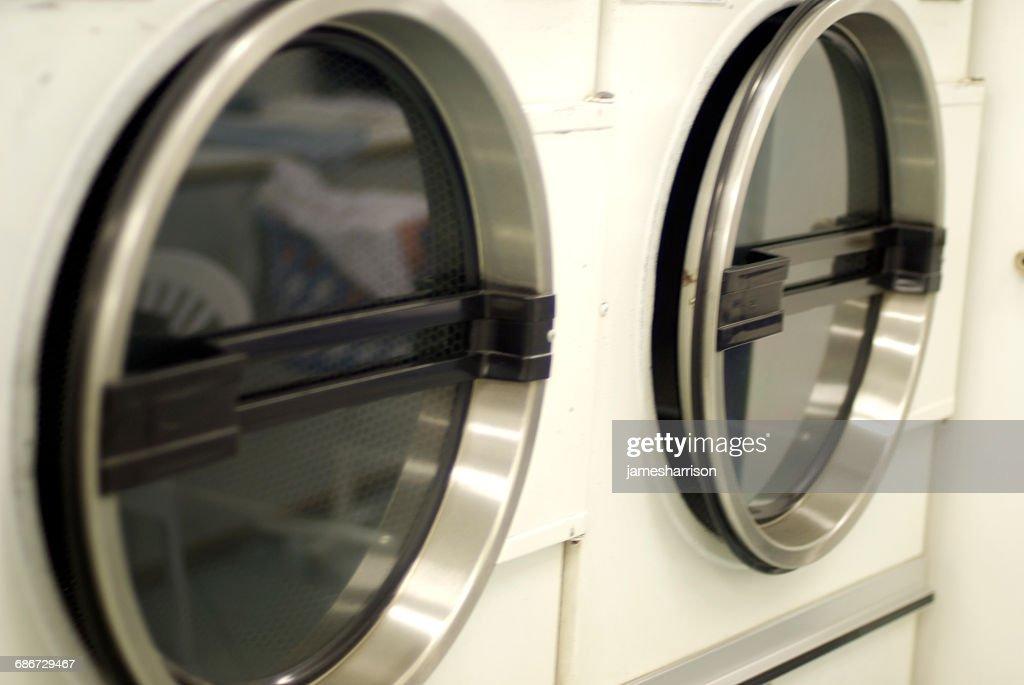 Close-up of Tumble drier washing machines : Stock Photo