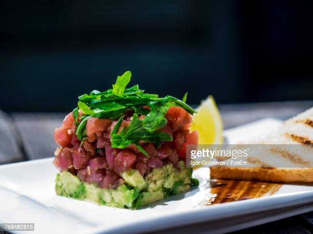 close-up of tuna tartare with avocados served in plate - igor golovniov stock pictures, royalty-free photos & images