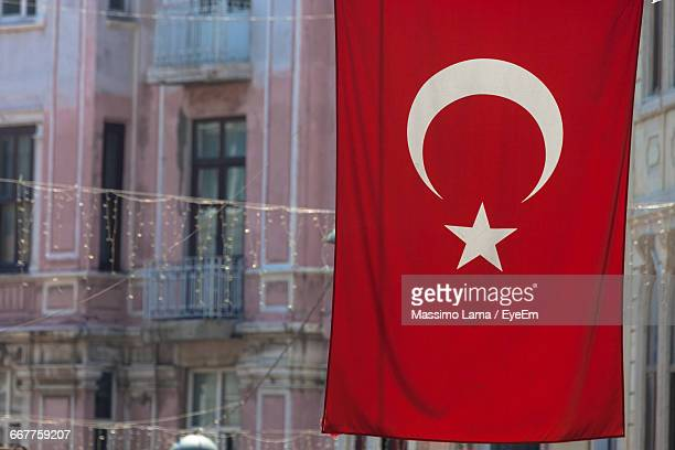 Close-Up Of Turkish Flag Against Building