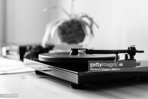 close-up of turntable on table - record analog audio stock pictures, royalty-free photos & images