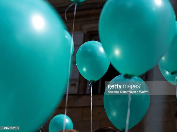 Close-Up Of Turquoise Helium Balloons At Wedding