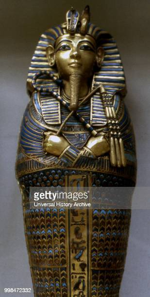 Close-up of Tutankhamen's second innermost coffin, also referred to as the intermediate coffin. It is made of gilded, laminated wood with inlays of...