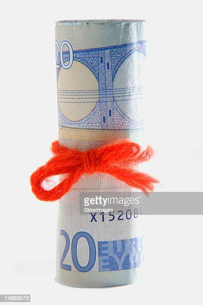 close-up of twenty euro money roll - twenty euro banknote stock photos and pictures