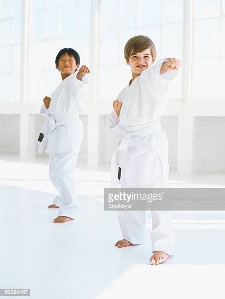 close-up of two boys punching - kampfsport stock-fotos und bilder