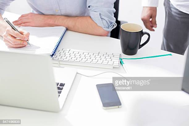 close-up of two businessmen at desk - マゾフシェ県 ストックフォトと画像