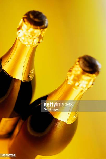 Close-up of two champagne bottles