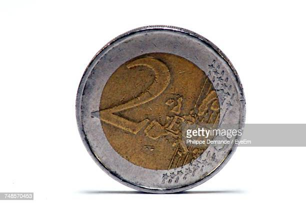 Close-Up Of Two Euro Coin Against White Background