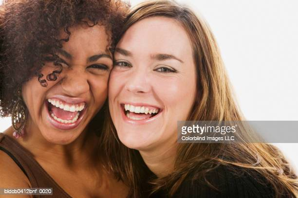 Close-up of two friends laughing
