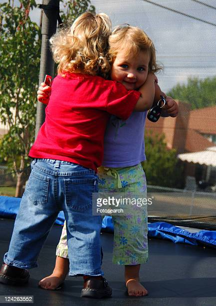 Close-up of two girls hugging each other