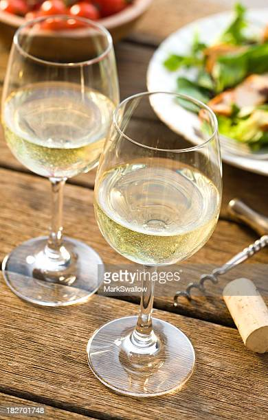 close-up of two glasses of white wine alfresco - white wine stock pictures, royalty-free photos & images