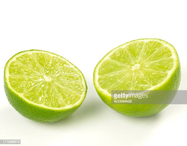 Close-up of two lime halves isolated on white