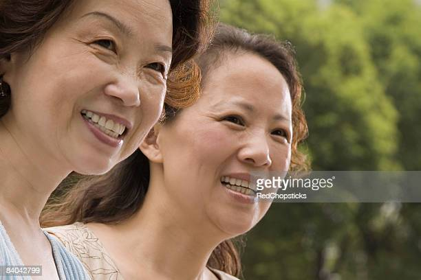 Close-up of two mature women smiling