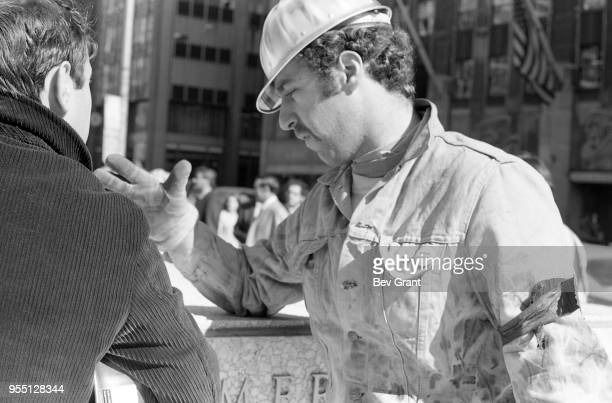 Closeup of two men as they talk together outside the Time Life Building during the Moratorium to End the War in Vietnam demonstration New York New...