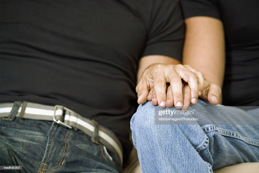 Close-up of two men holding hands : Stock Photo