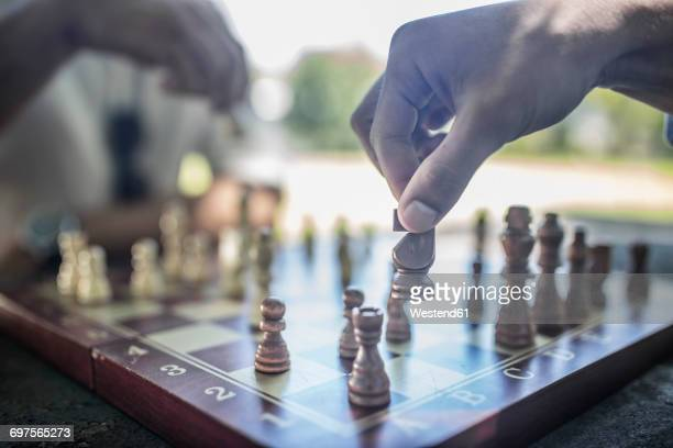 Close-up of two men playing game of chess