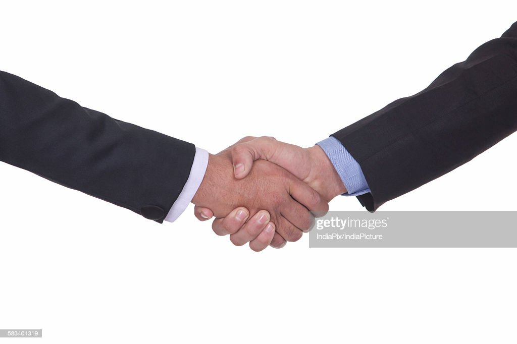 Close-up of two men shaking hands : Stock Photo