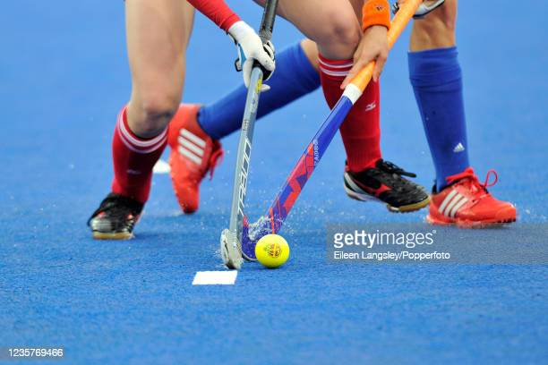 Close-up of two players tackling each other during the Pool A match between the Netherlands and Japan in the women's Field Hockey tournament on day 4...