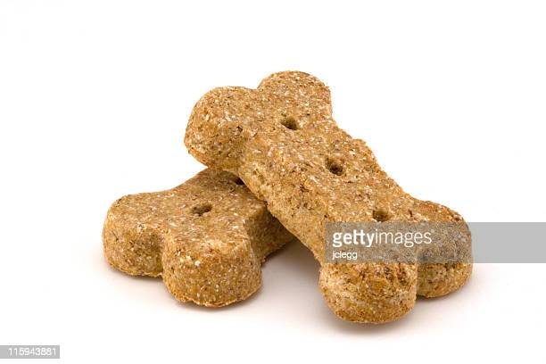 closeup of two processed dog bone shaped dog treats - animal bones stock photos and pictures